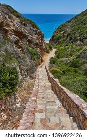 The path to the amazing Kaladi beach leading to a beautiful scenery with crystal clear water and the rock formation in Kythira island. Summer period. Ionian, Greece, Europe