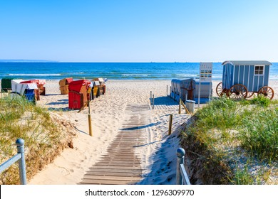 Path to beach with traditional wicker chairs in Binz summer resort, Ruegen island, Baltic Sea, Germany