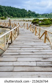 Path between hot springs and fumaroles at the edge of Furnas lake, Azores, Portugal, Europe