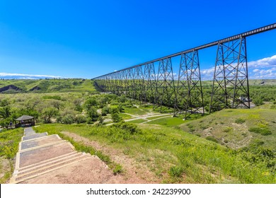 Path by the High Level Bridge in Lethbridge, Alberta, Canada. The bridge is the longest and highest trestle bridge in the world soaring above the Oldman River.