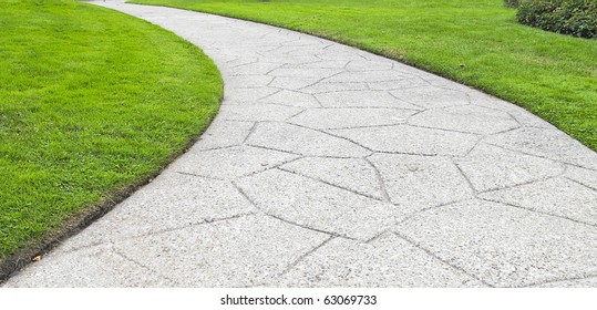 path curving through lawn in park