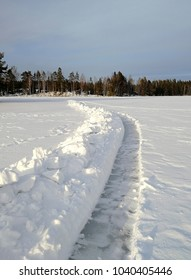 Path for ice walking on the lake ice. Sunny winter day in Finland