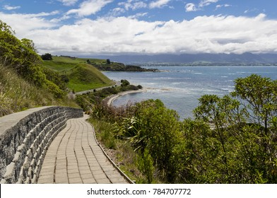Path of Kaikoura Peninsula Walkway with stone brick wall