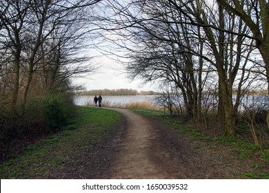 A path to the lake from the Geestmerambacht recreation area near the Dutch city of Alkmaar. Netherlands, February 18, 2020.
