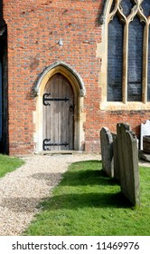 Path leading to an Arched Doorway of a Medieval English Village Church