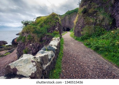Path leading to the Cushendun Cave in Northern Ireland, county of Antrim, which was used as a filming location in Game of Thrones TV series.