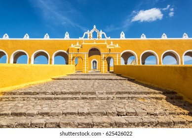 Path leading up to the entrance of the colonial monastery in Izamal, Mexico
