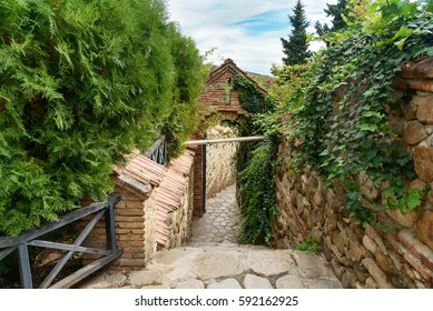 Path leading to St. Nino spring in Monastery of St. Nino at Bodbe. Cathedral was constructed in IV century, on the tomb of St. Nino. Sighnaghi. Kakheti region. Georgia.