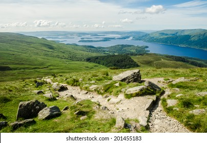 Path leading to the top of Ben Lomond in a sunny  day. Loch Lomond in the background. Scotland (UK).