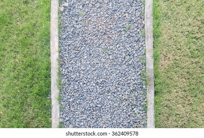 Path made from Construction Stone between Grasses in The Garden, Top View