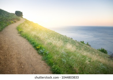 path in the mountains overlooking the sea.a view of the sea from a high cliff