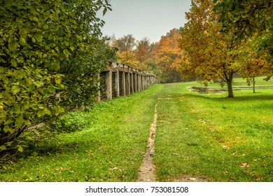 The path near the monastery fence in autumn