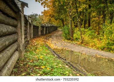 Path near the monastery fence in autumn