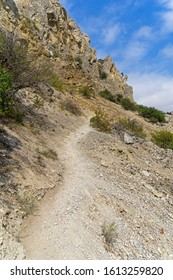 Path on a steep mountainside. Cape Alchak, Crimea. Sunny day in September.