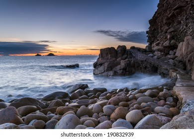 Path over rocks at Porth Nanven Cove near Lands End in Cornwall