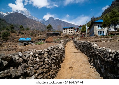 Path road along stone wall on the way to Everest Base Camp