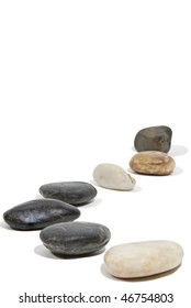 A path of rocks along a white seamless background.