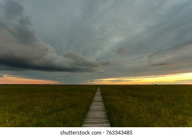 Path to scary stormy clouds sunset landscape