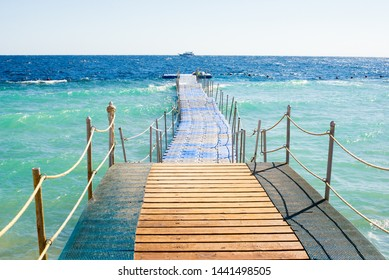 Path to sea with ship. pontoon pier in Egypt, red sea. Neutral view