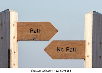Path sign choice. Follow destiny or make your own way through life. Debating spirituality, determinism and expectations. Choose an easy planned life or simply follow your heart. Ramblers sign post.