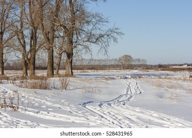 Path in the snow in the field
