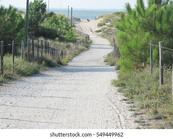 A path that goes directly on the sand of the beach