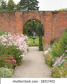 Path through an Arched Gateway to an English Walled Garden