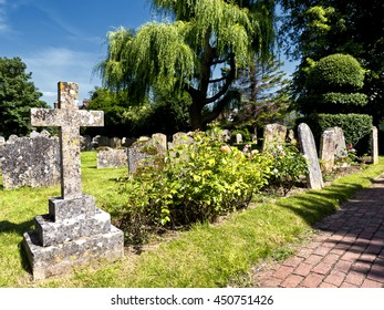 Path through English country churchyard; sunny day in thirteenth century Anglican country church yard
