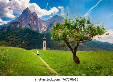 Path through the Meadow close to St Valentine's Church, near Seis am Schlern, Italy, with the Impressive Mountain Schlern in the Background