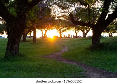 Path towards the sunset at Marinha do Brasil Park in Porto Alegre, Brasil