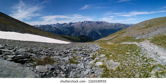 Path in a valley. The way to the col. Tourism in Altai mountains, Russia
