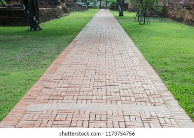 path way with red brick in Historical Park at Ayutthaya Thailand
