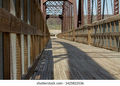Path of a wooden bridge leading off into the distance