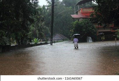 PATHANAMTHITTA, INDIA - AUG 16:Unidentified people walk through the flooded roads on August 16,2018 in Pathanamthitta,Kerala, India. Kerala was badly affected by the floods during the monsoon season