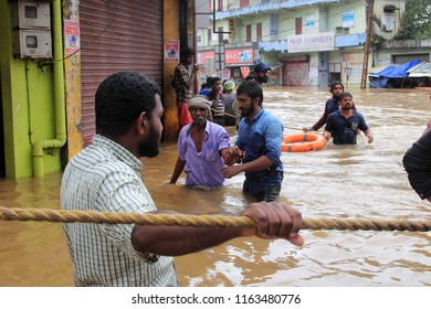 PATHANAMTHITTA, INDIA - AUG 17: Rescue team help people to escape from flooded area on August 17,2018 in Pathanamthitta,Kerala, India. Kerala was badly affected by the floods during the monsoon season