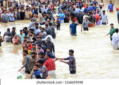 PATHANAMTHITTA, INDIA - AUG 17:People gather to rescue the affected people from flooded area on August 17,2018 in Pathanamthitta,Kerala, India. Kerala was badly affected by the floods during monsoon.