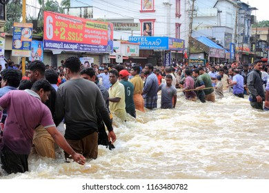 PATHANAMTHITTA, INDIA - AUG 17:People watch the rescue process in the flooded area on August 17,2018 in Pathanamthitta,Kerala, India. Kerala was badly affected by the floods during the monsoon season