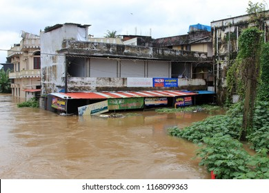 PATHANAMTHITTA, INDIA - AUG 17:Shops and buildings are submerged in the flood water on August 17,2018 in Pathanamthitta,Kerala, India. Kerala is badly affected by the floods during the monsoon season