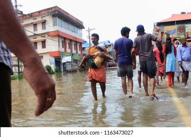 PATHANAMTHITTA, INDIA - AUG 17:Unidentified people walk through the flooded roads on August 17,2018 in Pathanamthitta,Kerala, India. Kerala was badly affected by the floods during the monsoon season