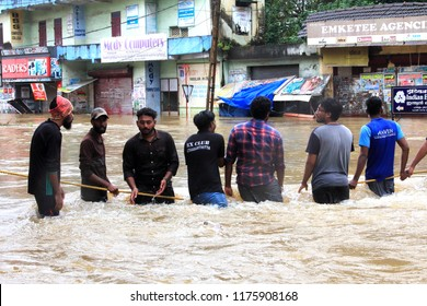 PATHANAMTHITTA, INDIA - AUG 18:People gather to rescue the affected people from flooded area on August 18,2018 in Pathanamthitta,Kerala, India. Kerala was badly affected by the floods during monsoon.