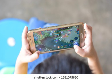 Pathein, Myanmar - April 21, 2019 : Asian Chinese boy playing Mobile Legends game