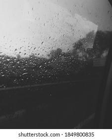 pathetic raindops on the windshield
