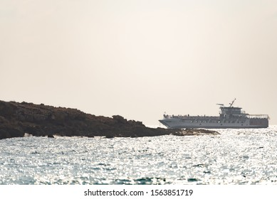 Pathos. Cyprus. The November 2019. The pleasure ship. The white ship with passengers. View from the shore on a passing passenger ship.