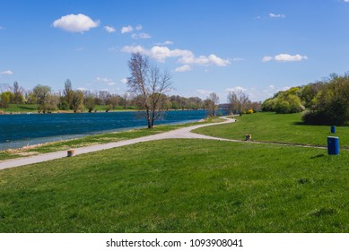 Paths on a Danube Island, view with Danube River in Vienna city, capital of Austria