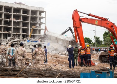 Pathum Thani, Thailand - 13 Aug 2014: the building collapse. during construction ( U Place Tower), Find many workers trapped inside ruins, tragedy occurred on Aug 11, 2014 at 16: 16 pm, In Thanyaburi.