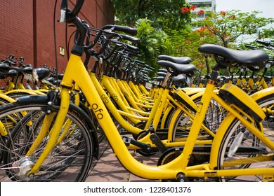 Pathum Thani, Thailand - April 27, 2018 : Ofo bikes are parked on the side of the road. Ofo is a bike-sharing service provider.