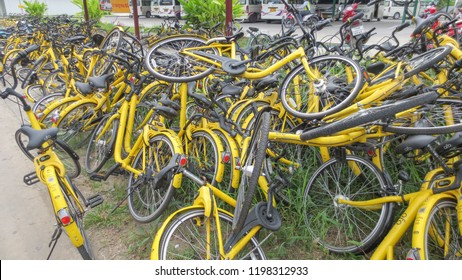 PATHUM THANI, THAILAND - AUGUST 18, 2018: stack pile of yellow OFO bicycle