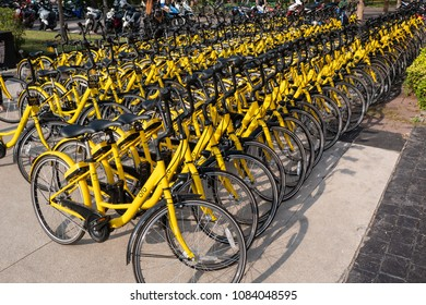 Pathum Thani, Thailand - January 15, 2018 : Ofo bikes are parked on the side of the road. Ofo is a bike-sharing service provider.