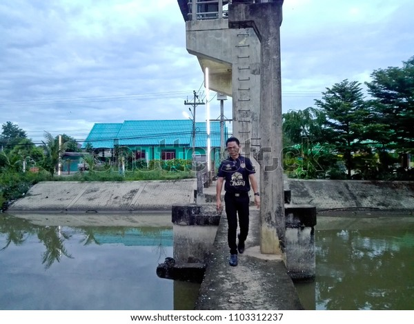 Pathum Thani, Thailand - May 29 2015 :  Mr. Tanakrit Phrombut  had been to water gate at Pathum Thani for  sight seeing.
