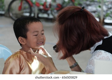Pathum Thani, Thailand, May 30, 2017: A doctor examining a student during a general health camp in rural school, Ban Bueng School, Pathum Thani.